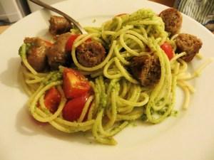 Spaghetti with pesto, sausage, & tomatoes